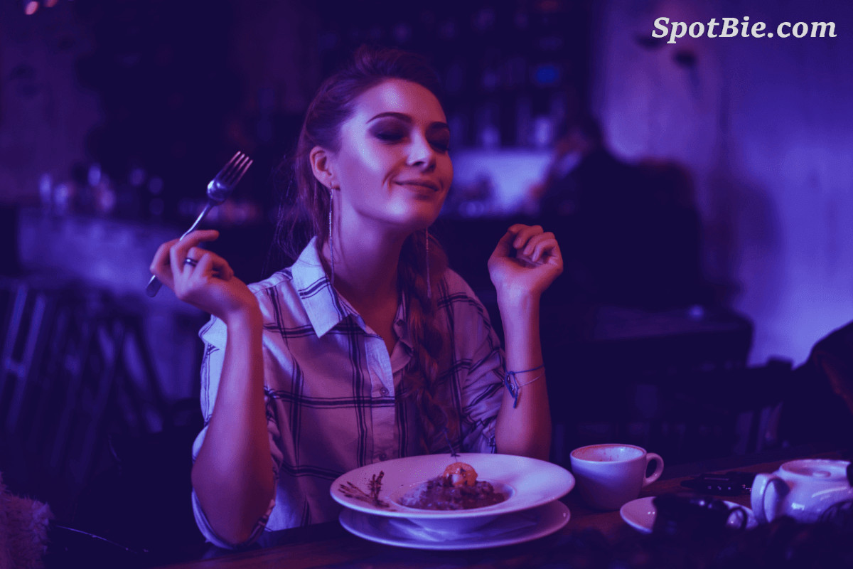 Image of woman enjoying her food after using SpotBie's feature to find good places to eat in Miramar.